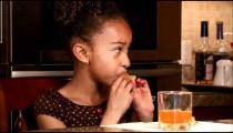 Girl eating chips.