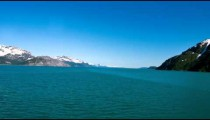 Traveling time lapse of snow capped mountains along Glacier Bay, AK