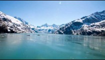 Snow capped mountains in Glacier Bay from a cruise ship turning around