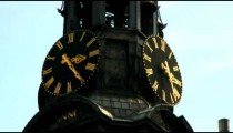 Two clock faces on a tower.