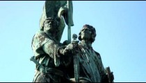 Statue of two men with a sword in Bruges, Belgium