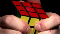 Close up of a Rubik's Cube being solved.