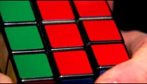 Extreme close up of a Rubik's Cube being solved.