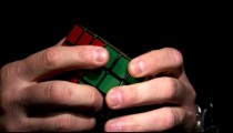 Rubik's Cube being solved on a black background.