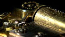 Close up of music box gears turning.
