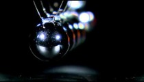 Rack focus of a Newton's Cradle in motion.