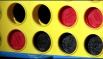 Discs falling into place in a Connect Four game.