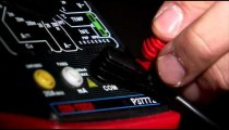 Close up of 2 cables plugging into an electrical tester.