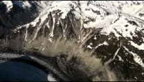 High angle aerial of the snow covered Coast Mountains and a small part of Glacier Bay in Alaska