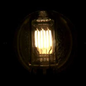 Close up of a light bulb with several filaments fading on then off.