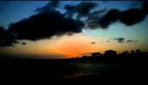 Time-lapse of the sun setting at Po'ipu Beach on Kauai, Hawaii.