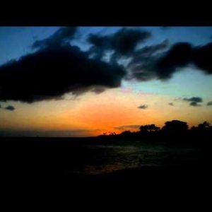Time-lapse of the sun setting at Po'ipu Beach on Kauai, Hawaii.