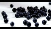Royalty Free Stock Footage of Clip of blueberries dropping onto a table.