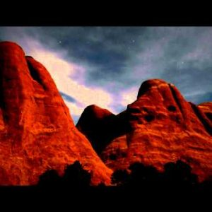 Time-lapse of stars and clouds over Moab, Utah rock formations.