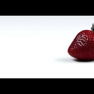 Royalty Free Stock Footage of Panning across a single strawberry.