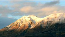 Time-lapse of the snow-capped Wasatch Mountains at dusk.