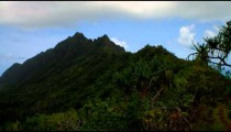 Time-lapse of green Hawaiian mountaintops.
