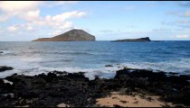 Time-lapse of the beach with Rabbit Island in the background in Hawaii.
