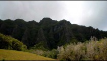 Time-lapse of a green Hawaiian mountainside.