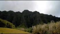 Time-lapse of a green Hawaiian mountainside.
