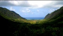 Time-lapse of a green Hawaiian valley.