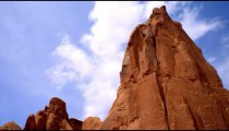 Time-lapse of the sky over a red rock tower.