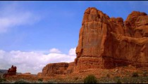 Time-lapse of red rock cliffs and the blue sky.