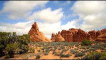 Time-lapse of clouds moving over red rock formations.
