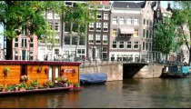 Time-lapse of a canal and its adjacent buildings.