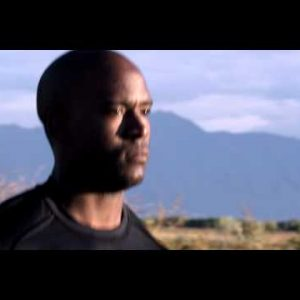 Royalty Free Stock Footage of Close up of man running with mountains in the background.