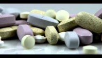Royalty Free Stock Footage of Panning shot across supplement pills.