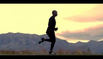 Royalty Free Stock Footage of Slow motion clip of a man running near mountains.