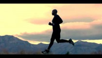 Royalty Free Stock Footage of Man running near mountains.