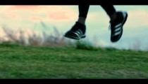 Royalty Free Stock Footage of Close up of a running man's feet.
