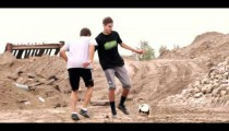 Royalty Free Stock Footage of Boys playing soccer in the dirt.