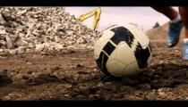 Royalty Free Stock Footage of Feet of two people playing soccer in the dirt.