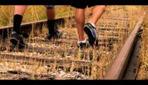 Royalty Free Stock Footage of Two boys walking down abandoned railroad tracks.