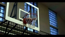 Royalty Free Stock Footage of Close up of a completed basketball shot.