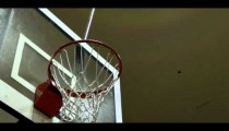 Royalty Free Stock Footage of Slam dunk by a young man.