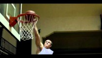 Royalty Free Stock Footage of Slam dunk by a young man filmed in slow motion.