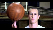 Royalty Free Stock Footage of Slow motion shot of a basketball spinning on a finger.
