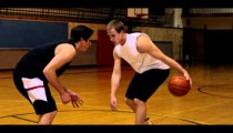Royalty Free Stock Footage of Dribbling a basketball between legs in a one-on-one game.