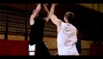 Royalty Free Stock Footage of Fade-away jump shot in a basketball game between two players.