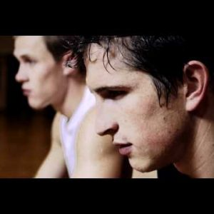 Royalty Free Stock Footage of Sweat dripping a young man's nose and hair.