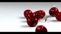 Royalty Free Stock Footage of Red cherries dropping onto a table.