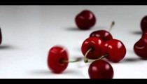 Royalty Free Stock Footage of Cherries falling onto a table.