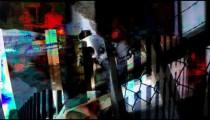 Colorful visualization of transparent skulls on fence background.