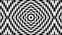 Intense kaleidoscopic effect on black and white checkerboard.