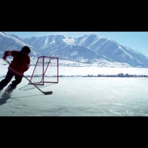Royalty Free Stock Footage of Young boy practicing hockey at an outdoor ice rink.