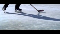 Royalty Free Stock Footage of Close up of a boy dribbling a hockey puck at an outdoor ice rink.